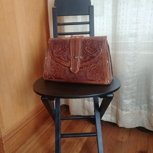 Beautiful vintage brown leather tooled clutch